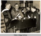 President Roosevelt Receives his Diploma from Dr. Holt