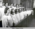 Chapel Choir of 1950 - 1951 sings in the pew
